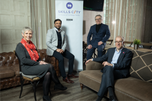 Left to Right, Debbie Brown, Strategic Director of Service Reform at Salford City Council; Mo Isap, CEO of HOST; Andy Beaden, CFO of HOST; and Tom Stannard, Chief Executive of Salford City Council